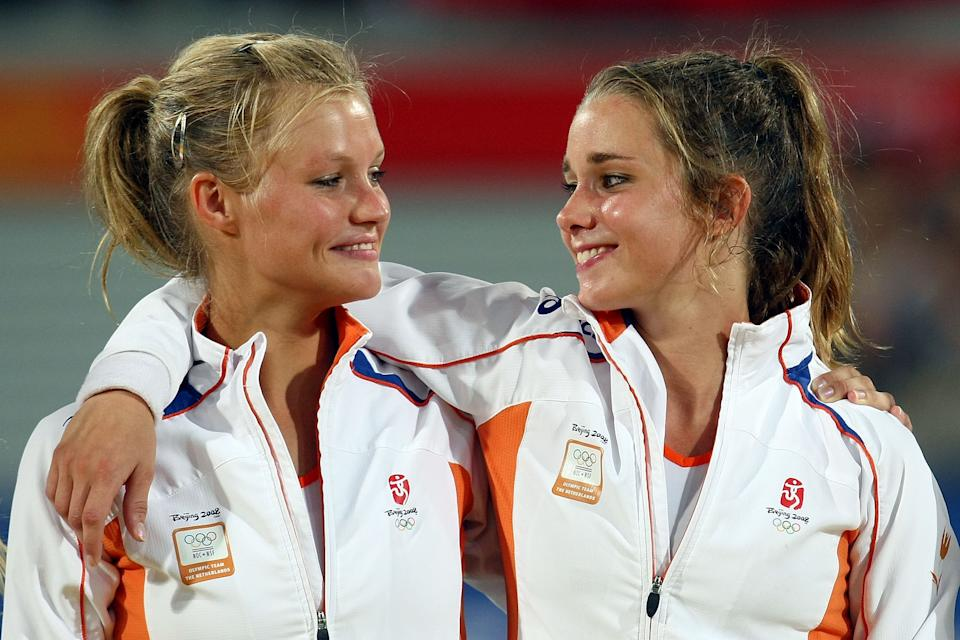 BEIJING - AUGUST 22: Sophie Polkamp (L) and Ellen Hoog of the Netherland pose with their gold medal in the women's hockey at the Olympic Green Hockey Field on Day 14 of the Beijing 2008 Olympic Games on August 22, 2008 in Beijing, China. (Photo by Lars Baron/Bongarts/Getty Images)