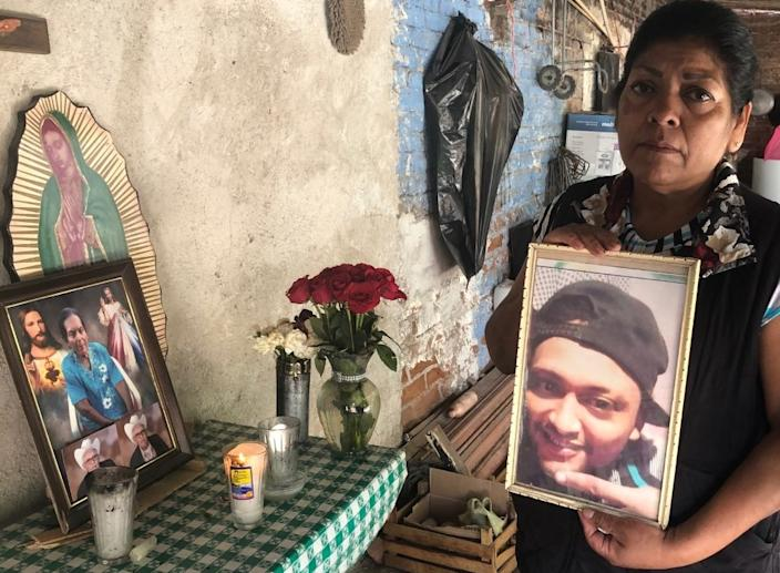 "Natalia Acosta Medina holds a photo of her slain son, Marco Antonio Castillo Medina. <span class=""copyright"">(Cecilia Sanchez / For The Times)</span>"