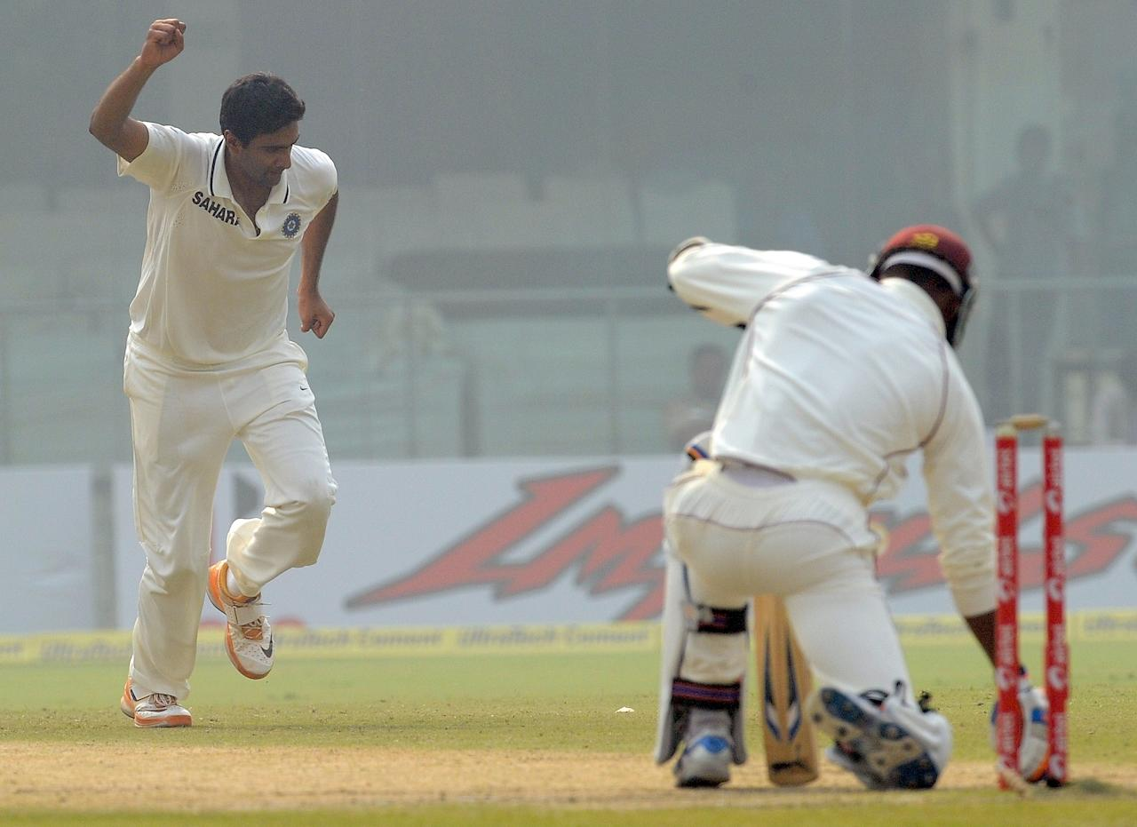 India cricketer Ravichandran Ashwin (L) celebrates the wicket of West Indies cricketer Marlon Samuels during the third day of the first Test cricket match at the Feroz Shah Kotla stadium in New Delhi on November 8, 2011. AFP PHOTO/ Prakash SINGH