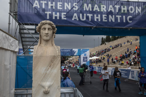 Runners finish their race inside the Panathenean stadium, ahead of the 37th Athens Marathon, on Sunday, Nov, 10, 2019. (AP Photo/Yorgos Karahalis)