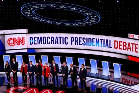 FILE PHOTO: The candidates stand on stage on the first night of the second 2020 Democratic U.S. presidential debate in Detroit
