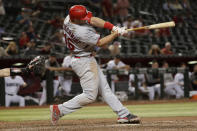 St. Louis Cardinals' Paul Goldschmidt connects on a solo home run against the Arizona Diamondbacks during the 13th inning of a baseball game, Tuesday, Sept. 24, 2019, in Phoenix. (AP Photo/Matt York)