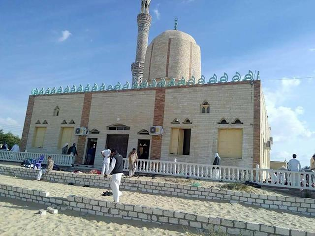 <p>View of the Rawda mosque, roughly 40 kilometers west of the North Sinai capital of El-Arish, after a gun and bombing attack, on Nov. 24, 2017. (Photo: STRINGER/AFP/Getty Images) </p>