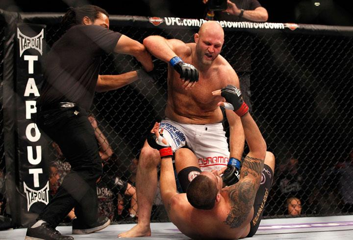 ATLANTA, GA - APRIL 21:  The official stops the fight as Ben Rothwell defeats Brendan Schaub in a knockout during their heavyweight bout for UFC 145 at Philips Arena on April 21, 2012 in Atlanta, Georgia.