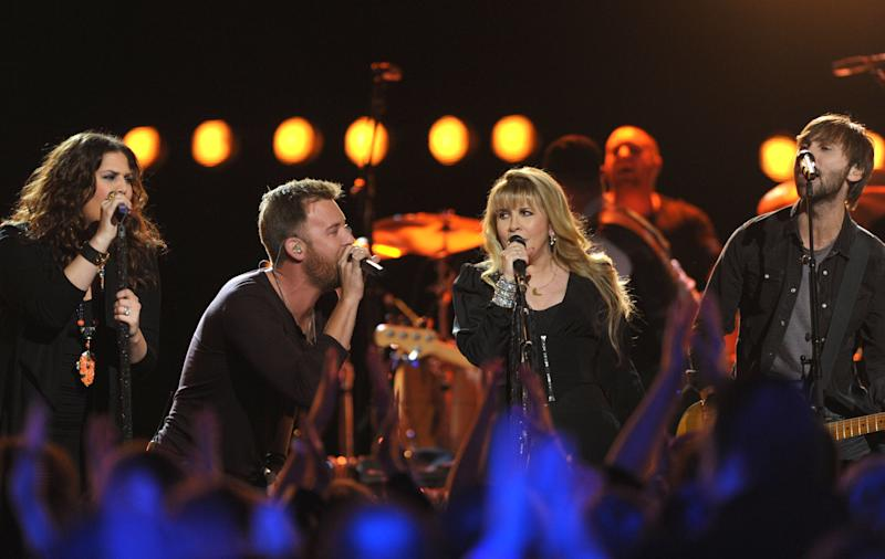 """FILE - This Jan. 29, 2013 file photo shows Hillary Scott, left, Charles Kelley, second left and Dave Haywood, right, of Lady Antebellum performing with Stevie Nicks at the CMT taping of """"Crossroads"""" in Culver City, Calif. The music special will air on Friday, Sept. 13 on CMT. (Photo by John Shearer/Invision/AP, File)"""