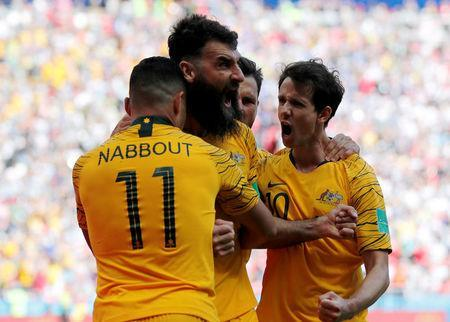 Soccer Football - World Cup - Group C - France vs Australia - Kazan Arena, Kazan, Russia - June 16, 2018 Australia's Mile Jedinak celebrates scoring their first goal with team mates REUTERS/Toru Hanai
