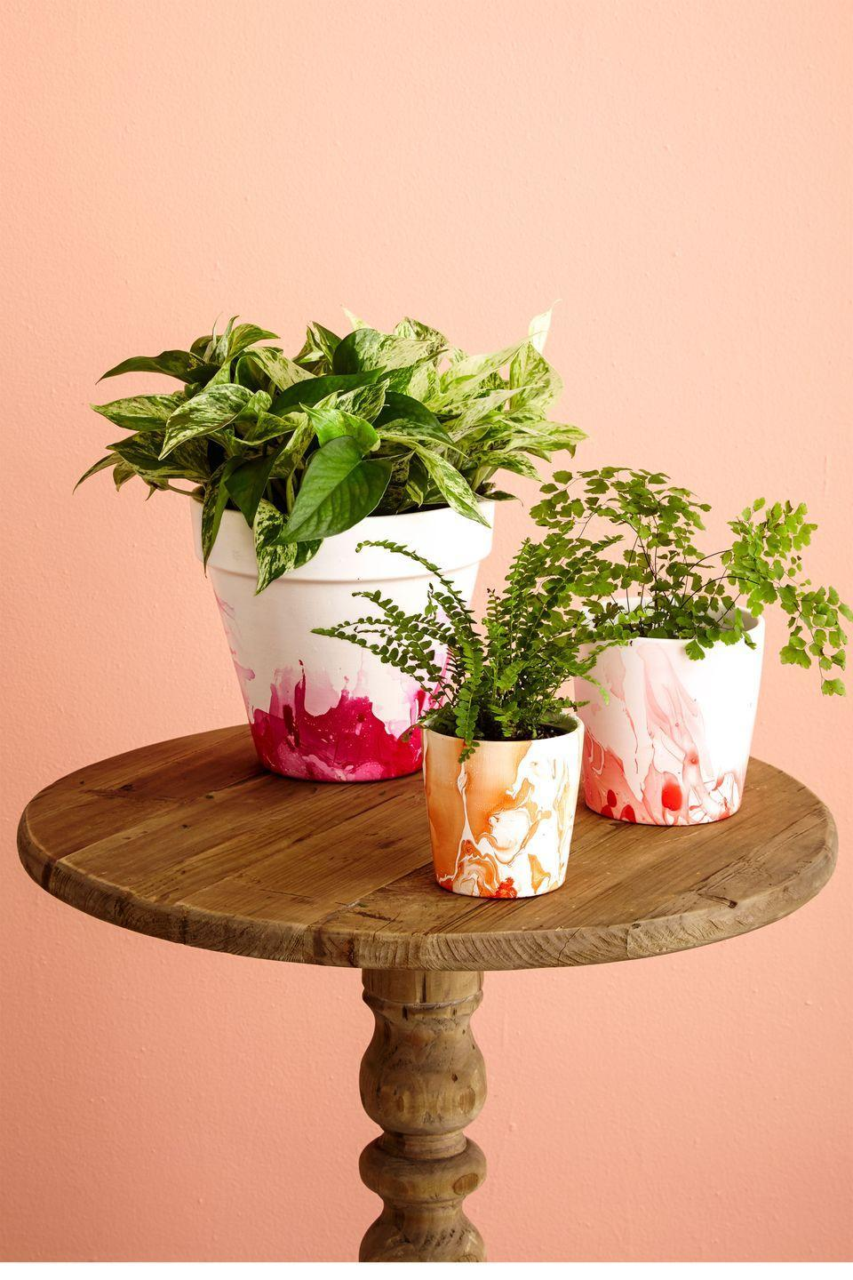"""<p>Create a marble effect on old terracotta pots with leftover nail polish.</p><p><strong>Materials</strong></p><p> • Terracotta pot</p><p> • Sponge paintbrush</p><p> • <a href=""""https://www.amazon.com/INSL-X-SXA110099-04-Waterborne-Bonding-Primer/dp/B000MITIF8/?tag=syn-yahoo-20&ascsubtag=%5Bartid%7C10070.g.2308%5Bsrc%7Cyahoo-us"""" rel=""""nofollow noopener"""" target=""""_blank"""" data-ylk=""""slk:Waterborne bonding primer"""" class=""""link rapid-noclick-resp"""">Waterborne bonding primer</a> </p><p> • White acrylic paint</p><p> • Plastic bucket or tub</p><p> • Nail polish</p><p> • Wood skewer</p><p><strong>1.</strong> On a protected work surface, brush a coat of primer onto the exterior and the inner rim of a clean pot. Once dry, apply two or more coats of paint, letting the pot dry completely between coats.</p><p><strong>2.</strong> Fill a bucket with enough room-temperature water to fully immerse the pot. Drizzle about ¼ of the bottle of nail polish over the water to create a film on the surface. Immediately use a skewer to swirl the polish before it gets too sticky, then dip the pot into the water bucket at an angle and rotate it, allowing the polish to adhere.</p><p><strong>3.</strong> Pull the pot out of the bucket and let the water drip off. Then, place it upside down on your work surface to dry. Flip it over and fill with a leafy or flowering houseplant.</p><p><strong>4.</strong> Weatherproof your pot with a coat of <a href=""""https://www.truevalue.com/multi-surface-waterproofer-12-oz-aerosol"""" rel=""""nofollow noopener"""" target=""""_blank"""" data-ylk=""""slk:Thompson's Aerosol Water Seal"""" class=""""link rapid-noclick-resp"""">Thompson's Aerosol Water Seal</a> to protect it from the elements.</p>"""