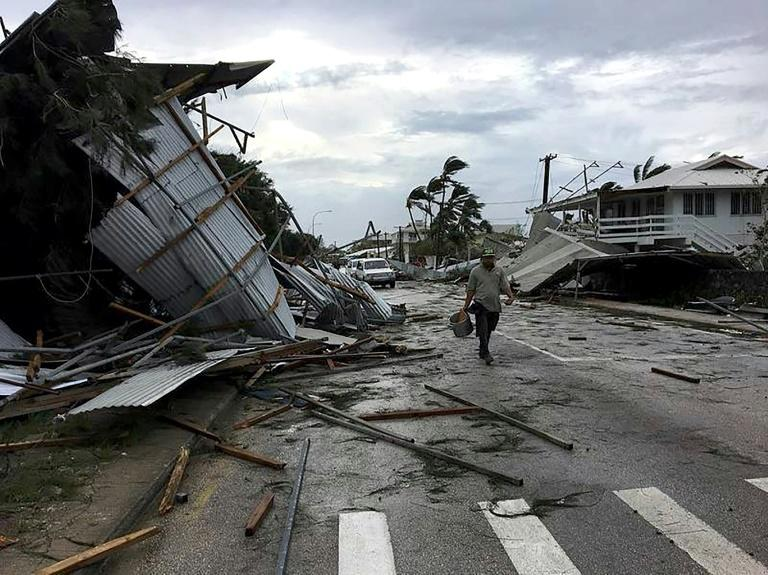 Flooding and damage in Tonga's capital of Nuku'alofa after Cyclone Gita hit the country
