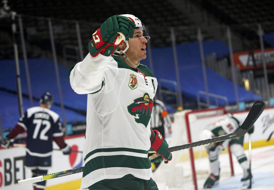 Minnesota Wild left wing Zach Parise reacts after scoring a goal against the Colorado Avalanche in the second period of an NHL hockey game Wednesday, Feb. 24, 2021, in Denver. (AP Photo/David Zalubowski)