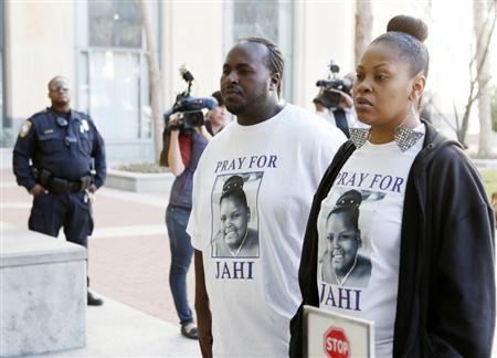 Nailah Winkfield, mother of Jahi McMath, and Martin Winkfield arrive at the U.S. District Courthouse for a settlement conference in Oakland
