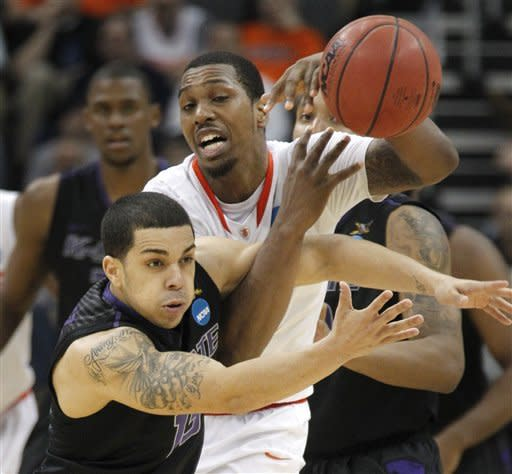 Kansas State's Angel Rodriguez, left, tries to steal the ball from Syracuse's Kris Joseph in the second half of an East Regional NCAA tournament third-round college basketball game of the NCAA college basketball game on Saturday, March 17, 2012 in Pittsburgh. Syracuse won 75-59. (AP Photo/Keith Srakocic)