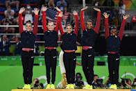 <p>(L to R) Gold Medalists Simone Biles, Gabrielle Douglas, Lauren Hernandez, Madison Kocian and Alexandra Raisman of the United States celebrate on the podium at the medal ceremony for the Artistic Gymnastics Women's Team Final on Day 4 of the Rio 2016 Olympic Games at the Rio Olympic Arena on August 9, 2016 in Rio de Janeiro, Brazil. (Photo by David Ramos/Getty Images) </p>