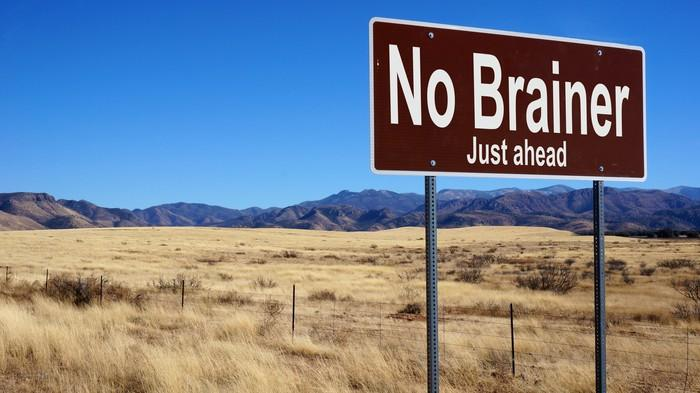 A brown highway sign that says the words no brainer just ahead.