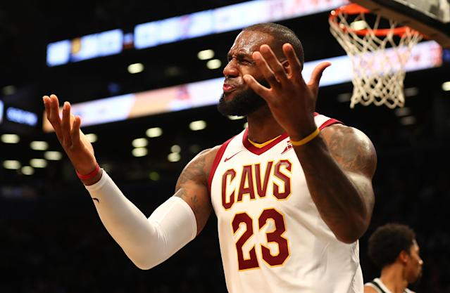 "<a class=""link rapid-noclick-resp"" href=""/nba/players/3704/"" data-ylk=""slk:LeBron James"">LeBron James</a> reacts to a call during the Cavs' Wednesday loss to the <a class=""link rapid-noclick-resp"" href=""/nba/teams/bro/"" data-ylk=""slk:Brooklyn Nets"">Brooklyn Nets</a> at Barclays Center. (Getty)"