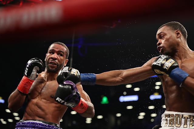 Errol Spence (R) fires a jab at Lamont Peterson on Saturday at the Barclays Center in Brooklyn. Spence won by eighth round TKO. (Getty Images)