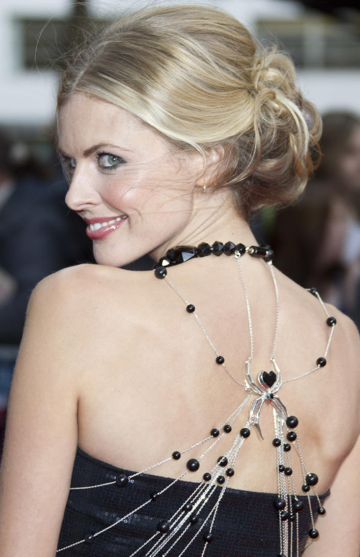 British actress Donna Air arrives in a Scott Henshaw creation for the UK premiere of The Amazing Spider-Man at a central London cinema, Monday, June 18, 2012. (AP Photo/Joel Ryan)