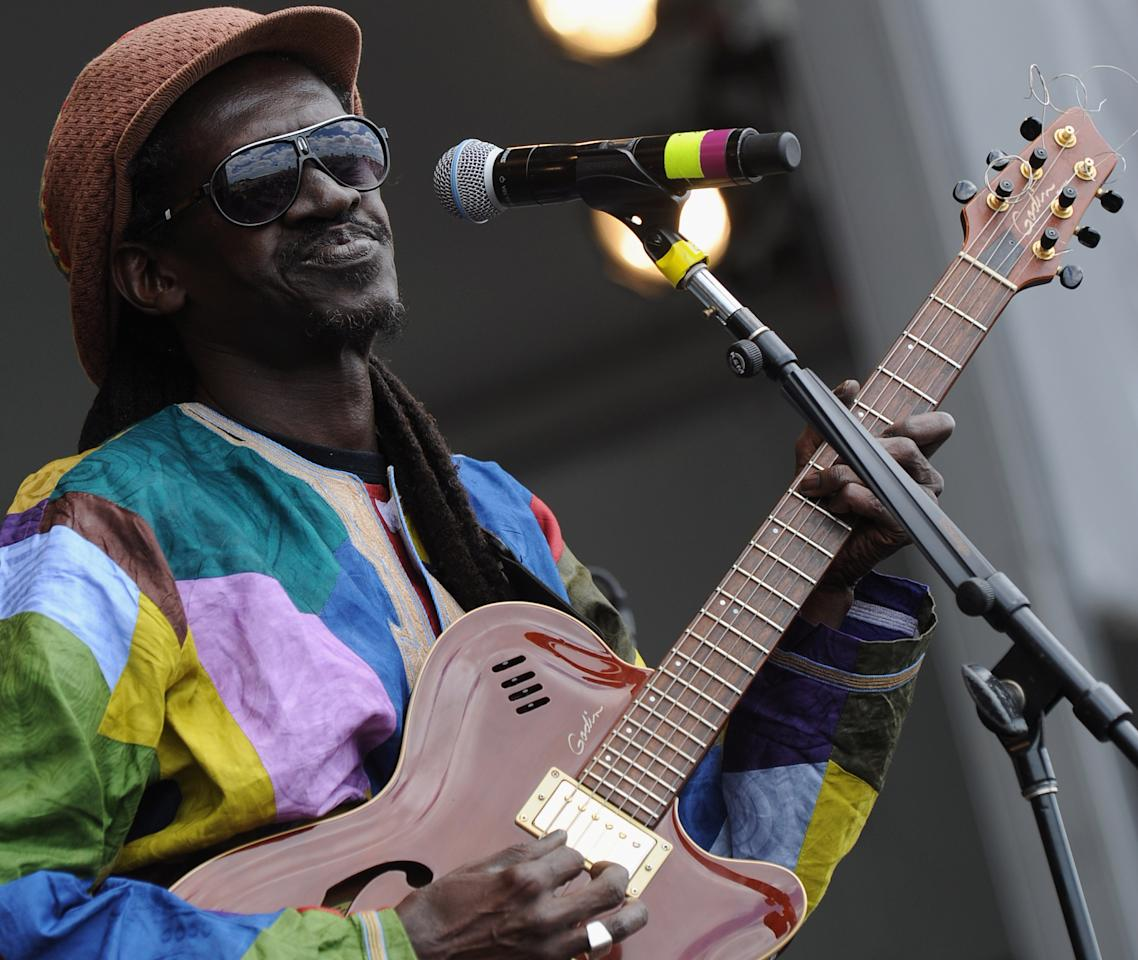 NEW ORLEANS, LA - APRIL 28:  Cheikh Lo of senegal performs during the 2012 New Orleans Jazz & Heritage Festival Day 2 at the Fair Grounds Race Course on April 28, 2012 in New Orleans, Louisiana.  (Photo by Rick Diamond/Getty Images)