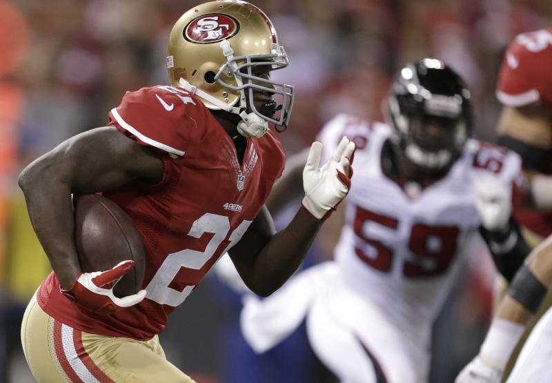 FILE - In this Dec. 23, 2013, file photo, San Francisco 49ers running back Frank Gore (21) carries against the Atlanta Falcons during the first half of an NFL football game in San Francisco. The NFL revealed Friday, Dec. 27, 2013, that the Chiefs and 49ers each had eight players voted into the Pro Bowl, including running backs Jamaal Charles of Kansas City and Gore of San Francisco. (AP Photo/Tony Avelar, File)