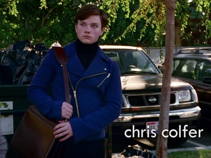 Kurt Hummel pairs his first look with a shoulder bag.
