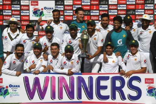 Pakistan's cricketers pose with their trophy after beating Sri Lanka at the National Cricket Stadium in Karachi -- their first home Test series in a decade