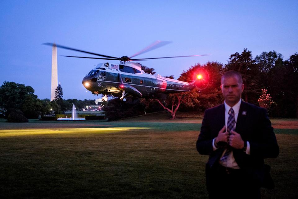 A Secret Service agent keeps watch as President Donald Trump arrives aboard Marine One on the South Lawn of the White House on May 23, 2018 in Washington, DC.  (Getty Images)