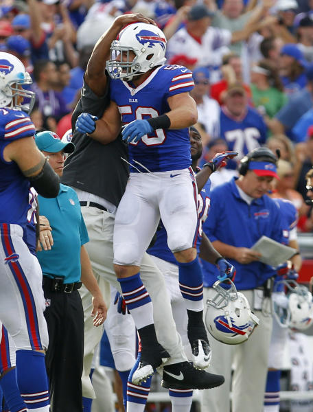 Buffalo Bills middle linebacker Kiko Alonso (50) celebrates his interception against the Baltimore Ravens during the second half of an NFL football game Sunday, Sept. 29, 2013, in Orchard Park, N.Y. Buffalo won 23-20. (AP Photo/Bill Wippert)