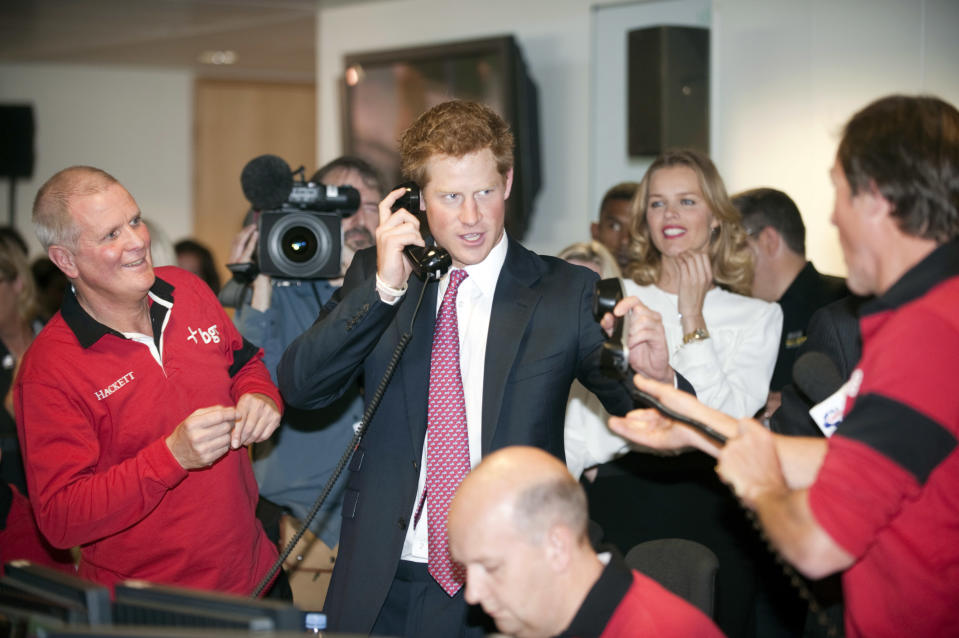 LONDON, UNITED KINGDOM - SEPTEMBER 12:  Prince Harry attends a fundraising day at the offices of BGC Partners on behalf of his charity Sentebale in Canary Wharf on September 12, 2011 in London, England. The Prince closed a record-breaking trade for 18 billion euros at the annual charity fundraising event organised by BGC who lost 658 employees during the terrorist attacks on the World Trade Center's twin towers on September 11, 2001 in New York.  (Photo by Paul Grover - WPA Pool/Getty Images)