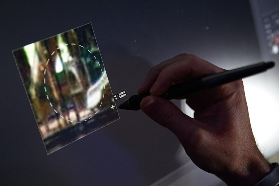 A computer forensic analyst reviews a case inside the Victim Identification Lab, part of Homeland Security's Child Exploitation Investigations Unit, in Fairfax, Va., Friday, Nov. 22, 2019. The Homeland Security Investigations section's little-known Child Exploitation Investigations lab is where agents scour disturbing photos and videos of child sexual abuse. They look for unlikely clues that help them identify the children and bring their abusers to justice. In one case, it was the loud, persistent chirping of a bird. Another time, it was unusual playground equipment. (AP Photo/Jacquelyn Martin)