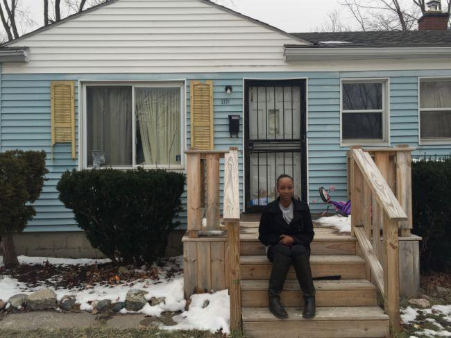 Kiki Phillips sits outside her home in Flint, Mich., on Jan. 25, 2016. Phillips recently received notice that her house will be put into foreclosure due to her inability to pay her accumulating water bills. (Caitlin Dickson/Yahoo News)