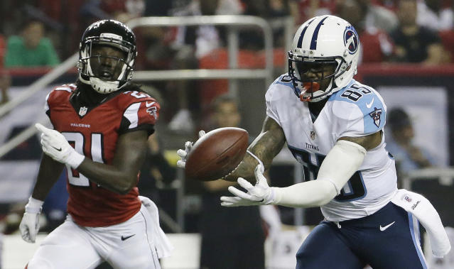 Tennessee Titans wide receiver Nate Washington (85) prepares to make the catch as Atlanta Falcons cornerback Desmond Trufant (21) look on during the first half of an NFL preseason football game, Saturday, Aug. 23, 2014, in Atlanta. Washington scored a touchdown on the play. (AP Photo/David Goldman)