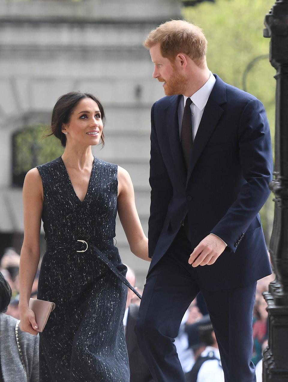<p>Markle opted for traditional black while Prince Harry sported a navy suit for the solemn occasion. </p>