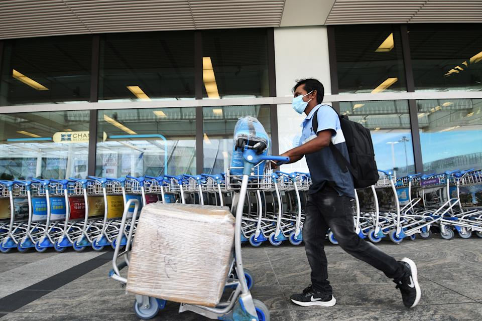 A man seen outside the departure hall of Changi Airport in Singapore on 19 August, 2021.(PHOTO: Xinhua via Getty Images)