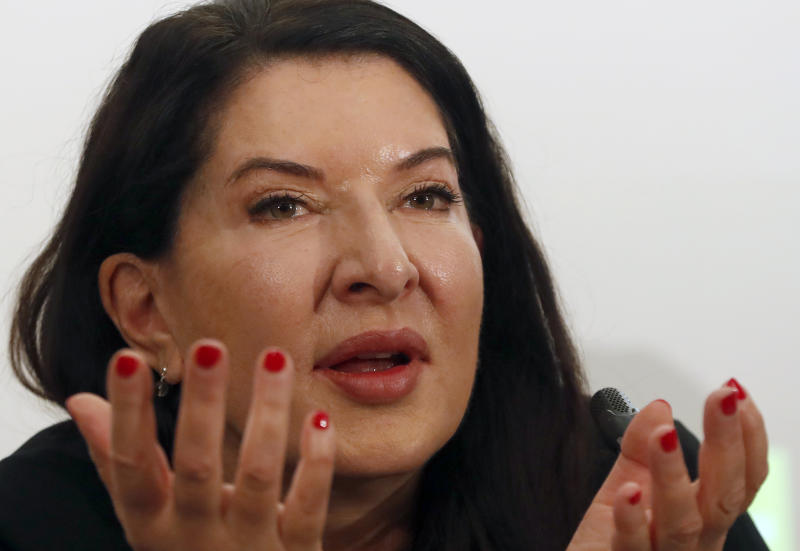 "Performance artist Marina Abramovic gestures during the press conference for her art exhibition ""Marina Abramovic - The Cleaner"" in the Museum of Contemporary Art in Belgrade, Serbia, Saturday, Sept. 21, 2019. Abramovic is displaying her work in her native Belgrade for the first time in 44 years and she says that returning home has been highly emotional. (AP Photo/Darko Vojinovic)"