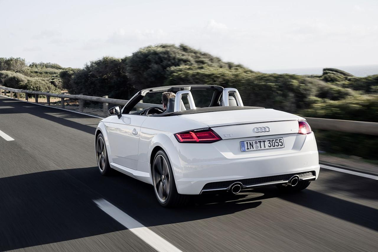 """<p>If you're looking for a true two-seater roadster experience, the <a rel=""""nofollow"""" href=""""https://www.roadandtrack.com/new-cars/first-drives/reviews/a8825/2016-audi-tt-and-tts-first-drive-review/"""">Audi TT</a> makes a compelling choice. It looks great, comes with Quattro all-wheel drive, and falls just under the $50,000 mark. </p>"""