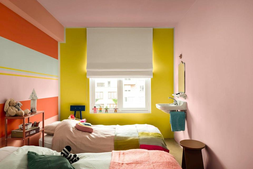 """<p>Create a bold and playful girls' bedroom with a combination of sunny yellow on one wall and alternately striped block colours on the adjoining wall using pink, orange and pale green. Finish the look by painting the ceiling in pink.</p><p>Pictured: Dulux Colour of the Year 2020 - Tranquil Dawn - Play Palette, <a href=""""https://go.redirectingat.com?id=127X1599956&url=https%3A%2F%2Fwww.dulux.co.uk%2Fen%2Fcolour-inspiration%2Fhow-to-use-dulux-2020-colour-palettes&sref=https%3A%2F%2Fwww.housebeautiful.com%2Fuk%2Fdecorate%2Fbedroom%2Fg35589644%2Fgirls-bedroom-ideas%2F"""" rel=""""nofollow noopener"""" target=""""_blank"""" data-ylk=""""slk:Dulux"""" class=""""link rapid-noclick-resp"""">Dulux</a></p>"""