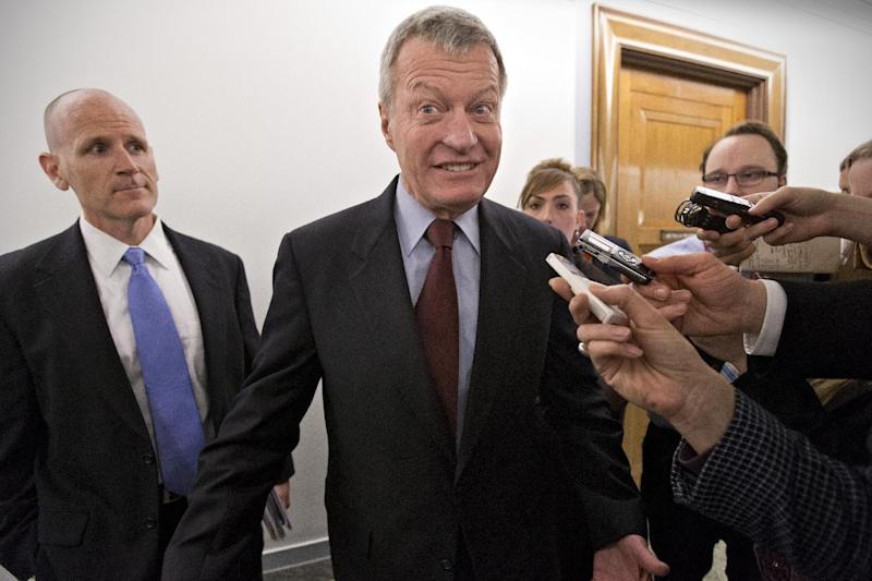 FILE - In this April 23, 2013, file photo, Senate Finance Committee Chairman Max Baucus, D-Mont., leaves his committee office at the Capitol, in Washington. Gun control forces are targeting Sens. Kelly Ayotte, Baucus and others as they struggle to persuade five senators to switch their votes and revive the rejected effort to expand background checks to more firearms buyers. (AP Photo/J. Scott Applewhite, File)