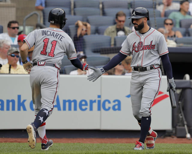 Atlanta Braves' Ender Inciarte (11) is congratulated by Nick Markakis after scoring against the New York Yankees during the fifth inning of a baseball game, Wednesday, July 4, 2018, in New York. (AP Photo/Julie Jacobson)