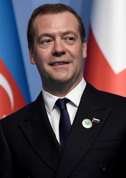 """Russia Prime Minister Dmitry Medvedev said the new sanctions stood as a """"declaration of a full-fledged economic war on Moscow (AFP Photo/OZAN KOSE)"""
