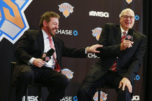 Phil Jackson (R) and New York Knicks owner James Dolan laugh during a news conference announcing Jackson as the team president of the New York Knicks basketball team at Madison Square Garden in New York March 18, 2014. REUTERS/Shannon Stapleton (UNITED STATES - Tags: SPORT BASKETBALL BUSINESS)