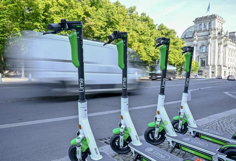E-scooters touted as zero-carbon urban transport are flooding city streets worldwide, but just how green they are remains an open question (AFP Photo/Tobias SCHWARZ)