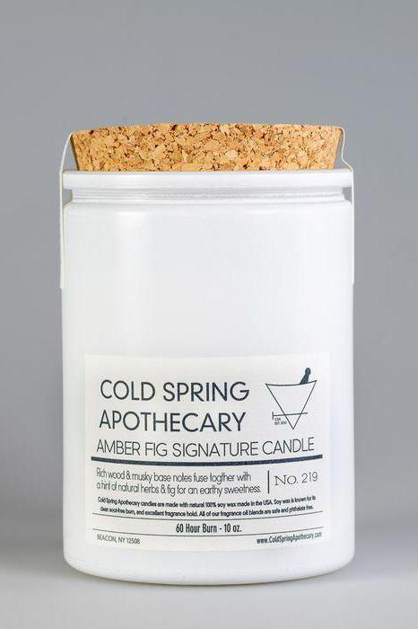 """<p><strong>Cold Spring Apothecary</strong></p><p>coldspringapothecary.com</p><p><strong>$35.00</strong></p><p><a href=""""https://www.coldspringapothecary.com/collections/home-goods-candles/products/amber-fig-candle-6oz"""" rel=""""nofollow noopener"""" target=""""_blank"""" data-ylk=""""slk:Shop Now"""" class=""""link rapid-noclick-resp"""">Shop Now</a></p><p>""""I buy all my candles from <a href=""""https://www.coldspringapothecary.com/collections/home-goods-candles"""" rel=""""nofollow noopener"""" target=""""_blank"""" data-ylk=""""slk:Cold Spring Apothecary"""" class=""""link rapid-noclick-resp"""">Cold Spring Apothecary</a> in Cold Spring, New York. I tend to gravitate towards more earthy scents, and their signature Amber & Fig candle is almost always burning in my home. The candles last a long time (about 60 hours) and are made with 100% natural soy wax, which is a must to really let the fragrance come through. If all that isn't enough to convince you, the candles are packaged in a beautiful way, and I have several jars that I repurpose throughout my home. It's always a good idea to shop small, but even more important this year, and they're just the absolute best."""" —<em>Katelyn Baker, deputy art director</em></p>"""