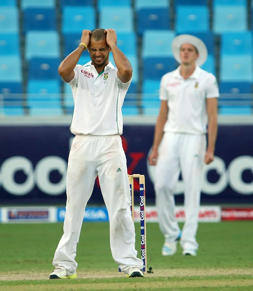 South African bowler JP Duminy reacts  during the third day of the second Test cricket match between Pakistan and South Africa in Dubai on October 25, 2013. AFP PHOTO/ MARWAN NAAMANI        (Photo credit should read MARWAN NAAMANI/AFP/Getty Images)