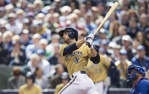 Milwaukee Brewers' Ryan Braun connects for a three run home run off of Chicago Cubs' Scott Feldman during the fifth inning of an MLB National League baseball game Sunday, April 21, 2013, in Milwaukee. (AP Photo/Tom Lynn)