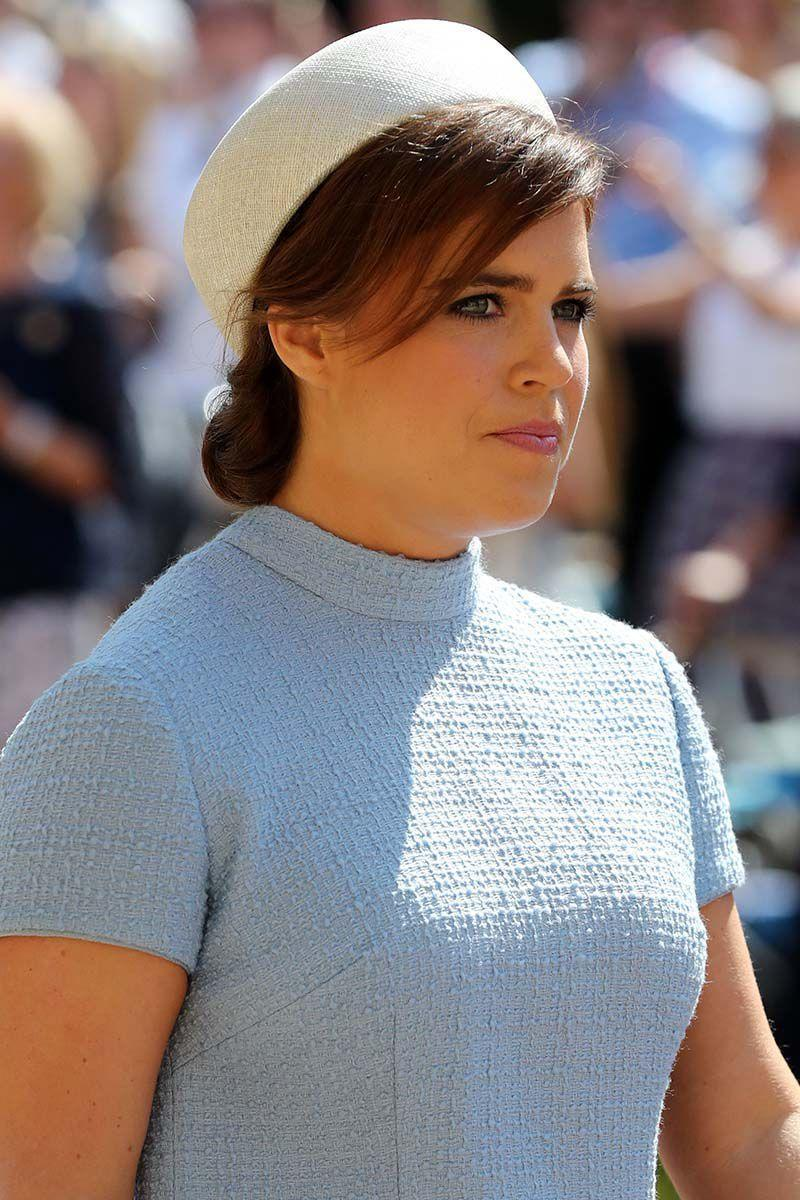 <p>Princess Eugenie sported a low side bun with side swept bangs under her pillbox hat for the nuptials of Prince Harry and Meghan Markle.</p>