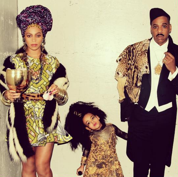 """<p>The songstress is already royalty (Queen Bey!), but she made it official as Queen Aoleon to the rapper's flawless Prince Akeem, complete with animal skin and 'stache, from Eddie Murphy's 1988 comedy <i>Coming to America</i>. While the movie is surely a classic in Blue's eyes, the tot played along as Imani Izzi. No word on whether she could do that intricate entrance dance. (Photo: <a rel=""""nofollow"""" href=""""https://www.instagram.com/p/9jpK_LPw2T/""""> Instagram</a>) </p>"""
