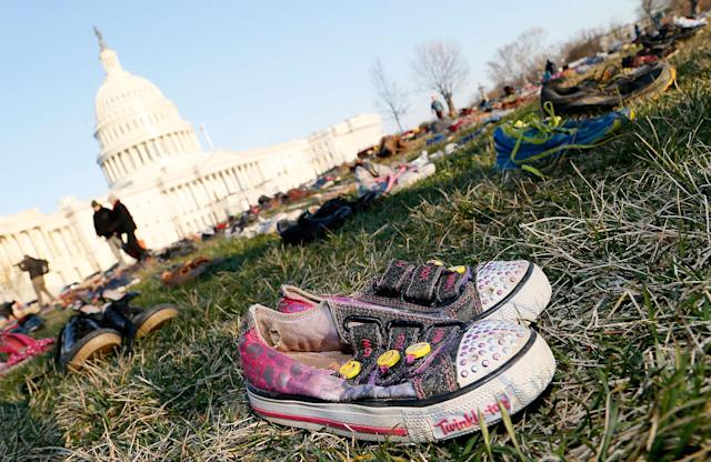<p>7,000 empty pairs of shoes for every child killed by guns in the US since Sandy Hook cover the southeast lawn of U.S. Capitol Building on Tuesday, March 13, 2018 in Washington, D.C. Avaaz gathered survivors, family members, and dozens of volunteers to create the installation calling on Congress to honor kids' lives with gun reform laws. (Photo: Paul Morigi/AP Images for AVAAZ) </p>