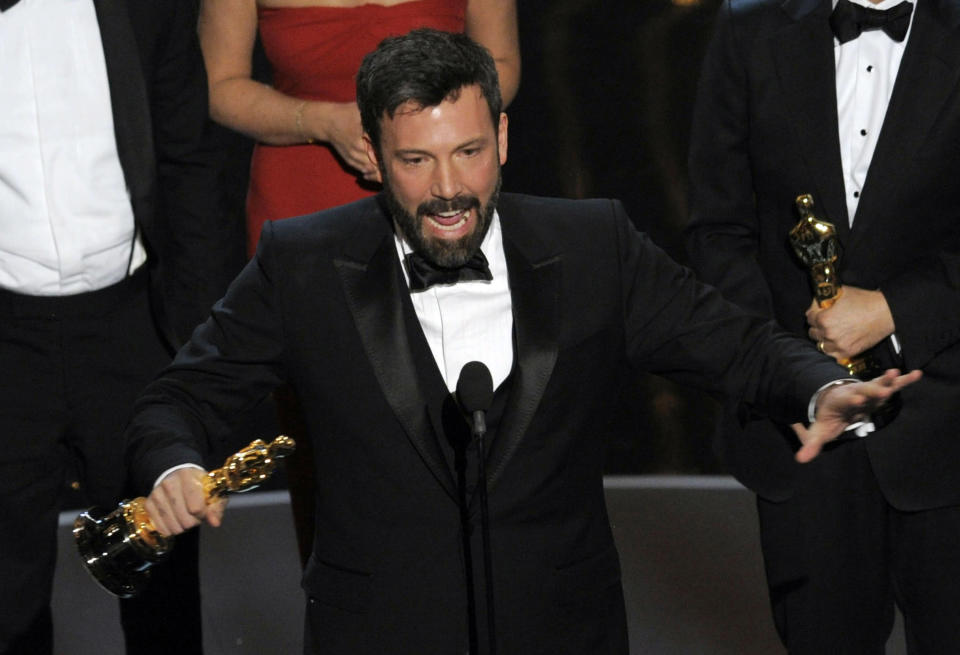"""FILE - In this Sunday Feb. 24, 2013 file photo, director and producer Ben Affleck accepts the award for best picture for """"Argo"""" during the Oscars at the Dolby Theatre, in Los Angeles. """"Argo"""" mentions New Zealand just once in passing, but the four-word reference is rankling Kiwis five months after the Oscar-winning film was released in the South Pacific nation. Even Parliament has expressed its dismay, passing a motion stating that director Ben Affleck """"saw fit to mislead the world about what actually happened."""" (Photo by Chris Pizzello/Invision/AP, File)"""