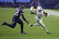 Indianapolis Colts running back Nyheim Hines (21) gets past Tennessee Titans linebacker Harold Landry (58) in the second half of an NFL football game Thursday, Nov. 12, 2020, in Nashville, Tenn. (AP Photo/Ben Margot)