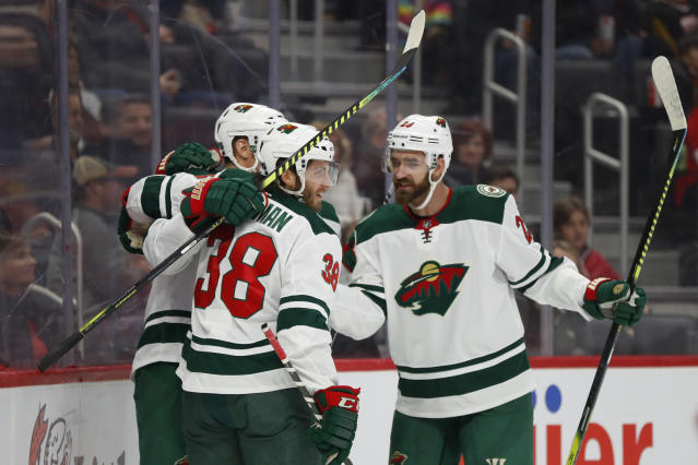 Minnesota Wild right wing Ryan Hartman (38) celebrates his goal against the Detroit Red Wings in the first period of an NHL hockey game Thursday, Feb. 27, 2020, in Detroit. (AP Photo/Paul Sancya)