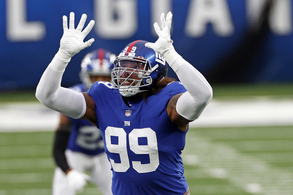 FILE - New York Giants defensive end Leonard Williams (99) is shown in action during an NFL football game against the Dallas Cowboys in East Rutherford, N.J., in this Sunday, Jan. 3, 2021, file photo. Leonard Williams got everything he wanted in a three-year, $63 million contract with the New York Giants before the start of free agency. (AP Photo/Adam Hunger, File)